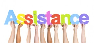 Multi-Ethnic Hands Holding Colorful Letters To Form Assistance
